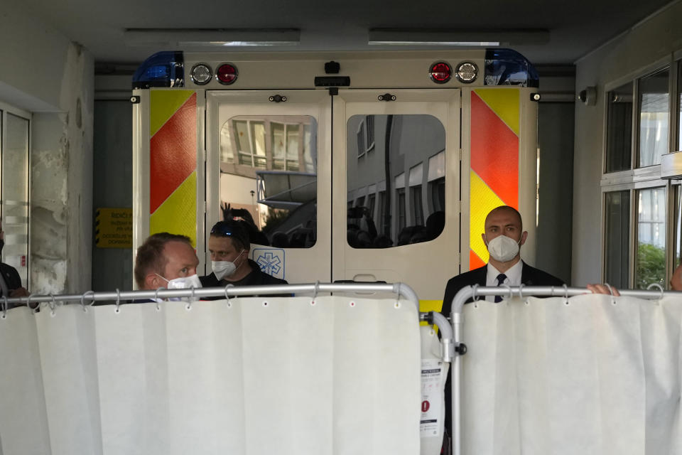 An ambulance carrying Czech Republic's President Milos Zeman arrives at the Military hospital in Prague, Czech Republic, Sunday, Oct. 10, 2021. Zeman is a heavy smoker who has suffered from diabetes and neuropathy linked to it. He has trouble walking and has been using a wheelchair. (AP Photo/Petr David Josek)