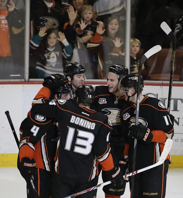 Members of the Anaheim Ducks celebrate left wing Dustin Penner's goal against the Los Angeles Kings during the second period of an NHL hockey game in Anaheim, Calif., Thursday, Jan. 23, 2014. (AP Photo/Chris Carlson)