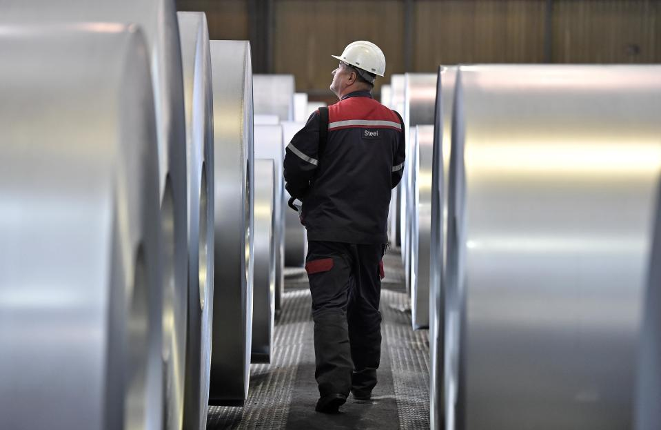 FILE - In this April 27, 2018 file photo, a worker controls steel coils at the thyssenkrupp steel factory in Duisburg, Germany. The European Union and the United States have decided to temporarily suspend measures at the heart of a steel tariff dispute that is seen as one of the major trade issues dividing the two sides. The issue goes back to the 2018 tariffs that then-President Donald Trump slapped on EU steel and aluminum, which enraged Europeans and other allies by calling their metals a threat to U.S. national security. (AP Photo/Martin Meissner, File)
