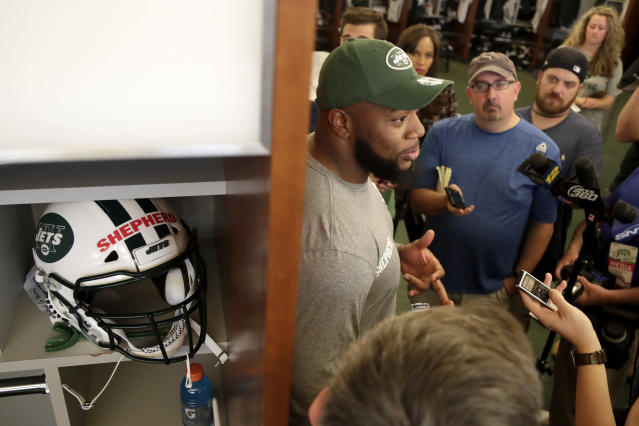 New York Jets' Nathan Shepherd, who was drafted in the third round of the 2018 draft, stands by his temporary locker while speaking to reporters during NFL rookie camp, Saturday, May 5, 2018, in Florham Park, N.J. (AP Photo/Julio Cortez)