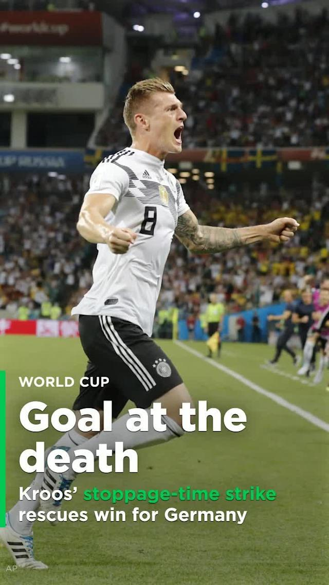 For most of Saturday's match against Sweden, defending World Cup champion Germany's hopes of repeating appeared to be hanging by a thread. But a full five minutes into stoppage time, midfielder Tony Kroos stepped up to a free kick deep in Sweden's end and curled his right footed shot past keeper Robin Olsen, the 2-1 victory vaulting Germany into second place in the Group F behind Mexico.
