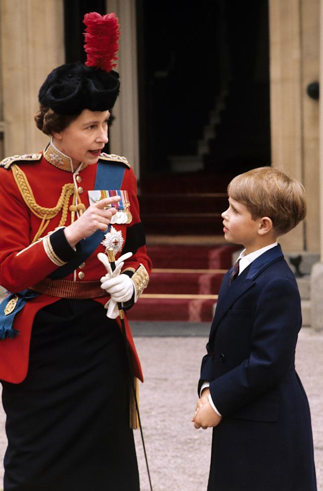 The Queen as she explains the details of the Trooping of the Colour to Prince Edward at Buckingham Palace in 1972. (Getty Images)