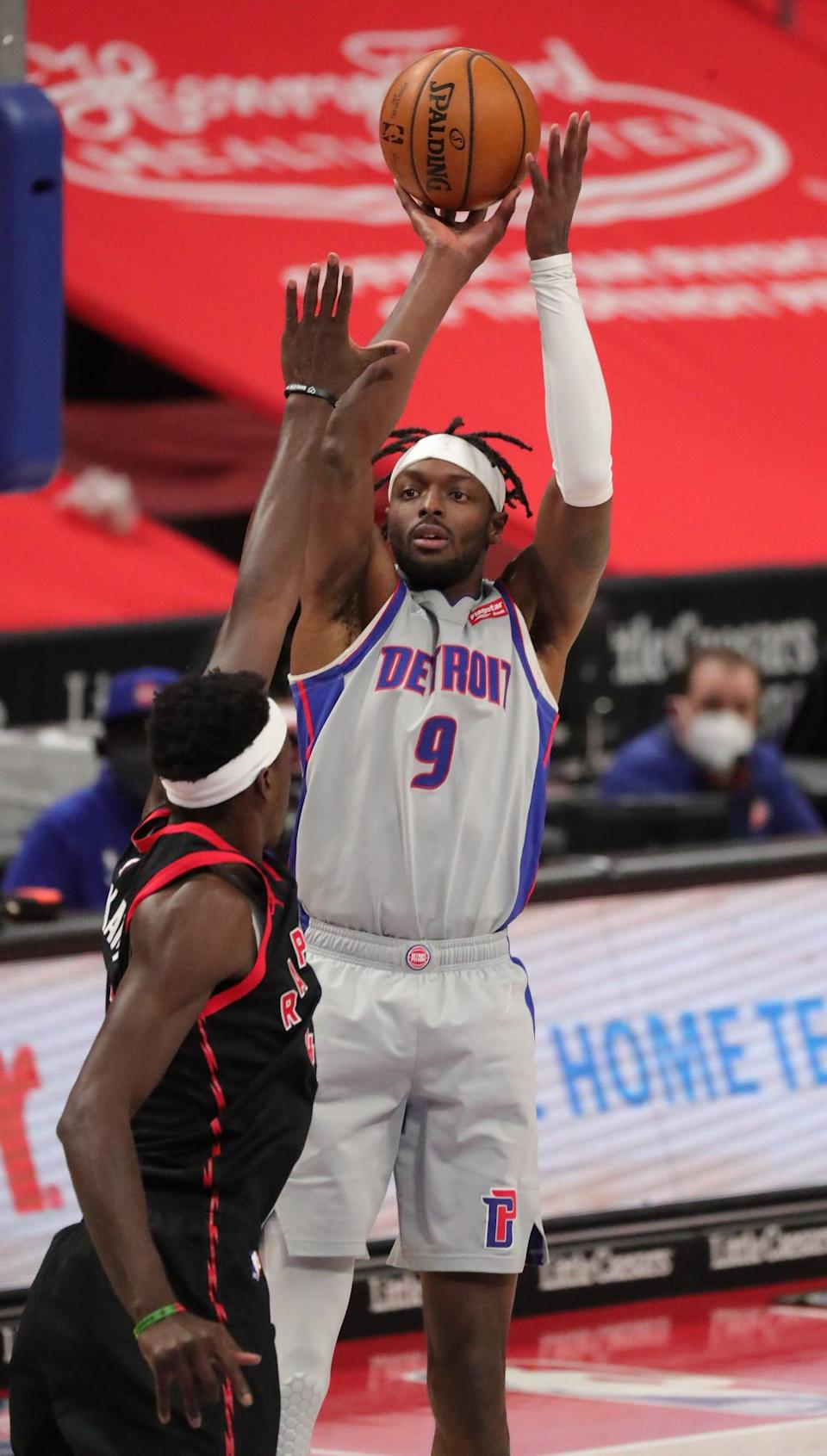 Pistons forward Jerami Grant shoots over Raptors forward Pascal Siakim on Monday, March 29, 2021 at Little Caesars Arena.