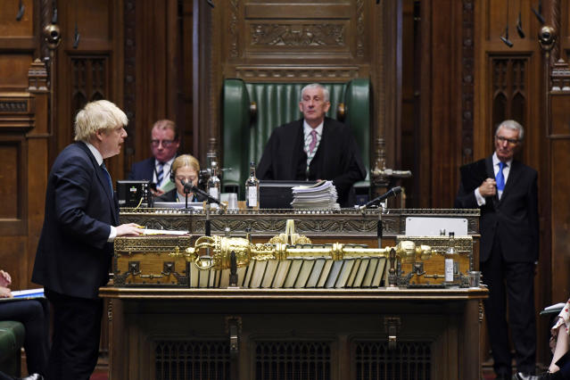In this handout photo provided by UK Parliament, Britain's Prime Minister Boris Johnson speaks during Prime Minister's Questions in the House of Commons, London, Wednesday, May 13, 2020. (Jessica Taylor/UK Parliament via AP)