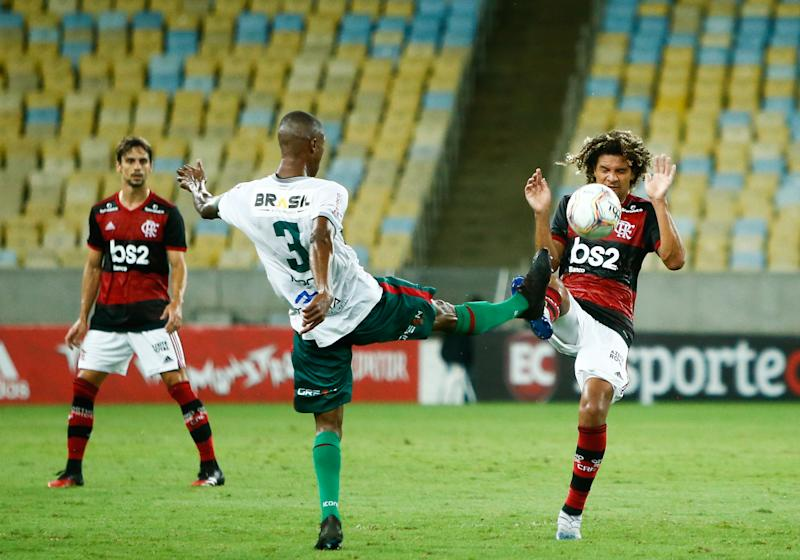 RIO DE JANEIRO, BRAZIL - MARCH 14: (L-R) Marcao of Portuguesa and Willian Arao of Flamengo fight for the ball during a match between Flamengo and Potuguesa as part of the Rio State Championship 2020, to be played behind closed doors at Maracana Stadium on March 14, 2020 in Rio de Janeiro, Brazil. The Government of the State of Rio de Janeiro issued a list of new guidelines to help prevent the spread of the coronavirus (COVID-19) which included the matches must be played behind closed doors and no public. According to the Ministry of Health, as of Friday March 13th, Brazil had 98 confirmed cases of coronavirus. (Photo by Bruna Prado/Getty Images)