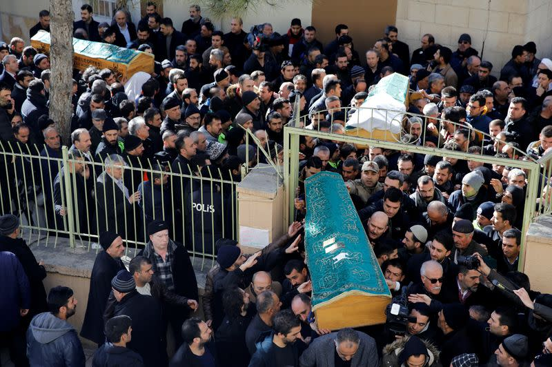 Man grieves during a funeral for earthquake victims in Elazig