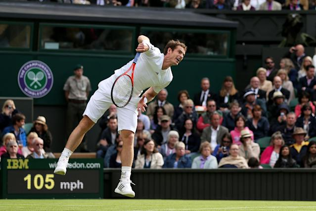 LONDON, ENGLAND - JUNE 24: Andy Murray of Great Britain serves during his Gentlemen's Singles first round match against Benjamin Becker of Germany on day one of the Wimbledon Lawn Tennis Championships at the All England Lawn Tennis and Croquet Club on June 24, 2013 in London, England. (Photo by Clive Brunskill/Getty Images)
