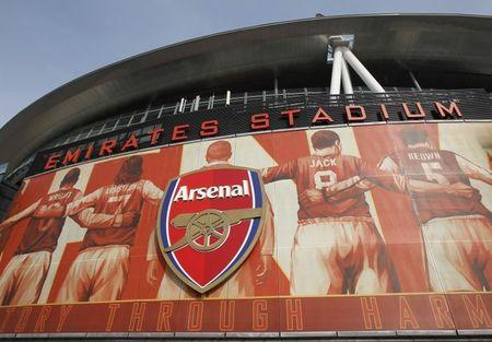 The crest of English Premier League soccer club Arsenal is seen in front of their home ground,  the Emirates Stadium, in London