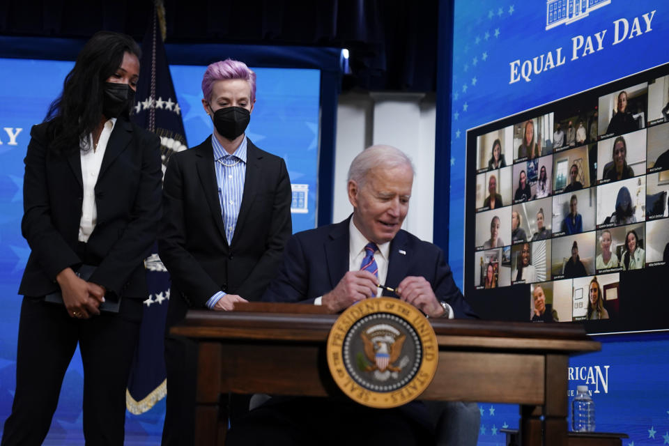 USWNT players Margaret Purce, left, and Megan Rapinoe met with President Joe Biden at an Equal Pay Day event at the White House last week. (AP Photo/Evan Vucci)