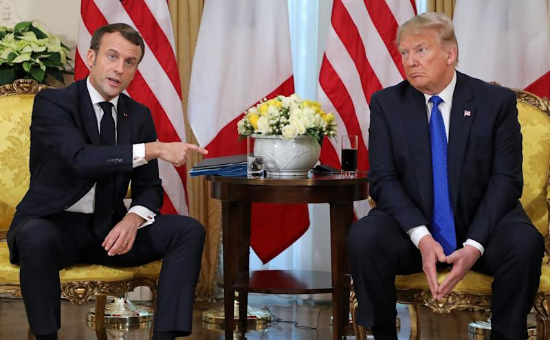 US President Donald Trump (R) and France's President Emmanuel Macron react as they talk during their meeting at Winfield House, London on December 3, 2019. - NATO leaders gather Tuesday for a summit to mark the alliance's 70th anniversary but with leaders feuding and name-calling over money and strategy, the mood is far from festive. (Photo by ludovic MARIN / various sources / AFP) (Photo by LUDOVIC MARIN/AFP via Getty Images)
