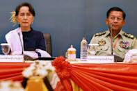 Myanmar's civilian leader Aung San Suu Kyi appears in October 2018 along side Senior General Min Aung Hlaing, who has led a coup in which she was arrested