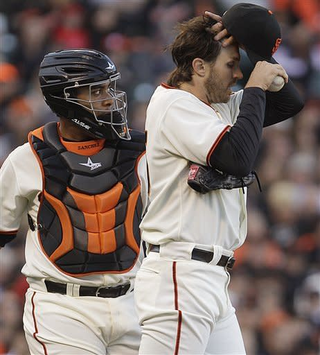 San Francisco Giants' Barry Zito, right, runs a hand through his hair as catcher Hector Sanchez, left, meets him on the mound during the first inning of a baseball game against the Pittsburgh Pirates Saturday, April 14, 2012, in San Francisco. (AP Photo/Ben Margot)