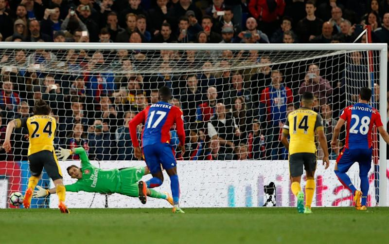 Crystal Palace's Luka Milivojevic scores their third goal from the penalty spot - Credit: Reuters