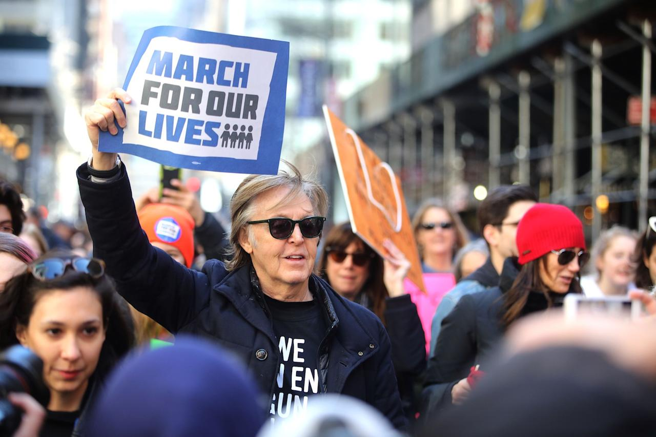 <p>Paul McCartney attends the March For Our Lives protest against gun violence in N.Y.C., telling CNN he lost one of his best friends (fellow Beatle John Lennon) to gun violence. (Photo: Getty Images) </p>