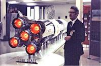 Jesco von Puttkamer, a NASA engineer instrumental in the development of the Saturn V rocket booster seen here with a model of the rocket, died Dec. 27 at 79 after a brief illness.