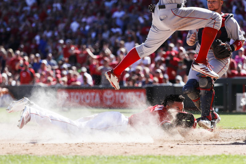 Billy Hamilton scored from first on a failed pick-off that turned into a pickle. (AP)