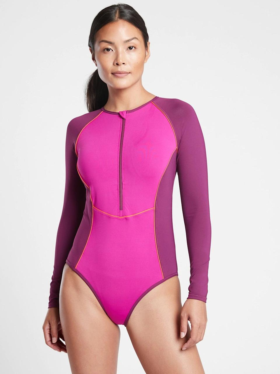 <p>This <span>Athleta Colorblock Long Sleeve One Piece Swimsuit</span> ($128) is both sporty and functional; we love it.</p>
