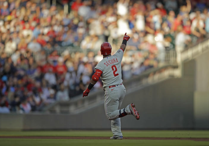 Philadelphia Phillies' Jean Segura celebrates after hitting a home run off Atlanta Braves pitcher Ian Anderson in the first inning of a baseball game Saturday, May 8, 2021, in Atlanta. (AP Photo/Ben Margot)