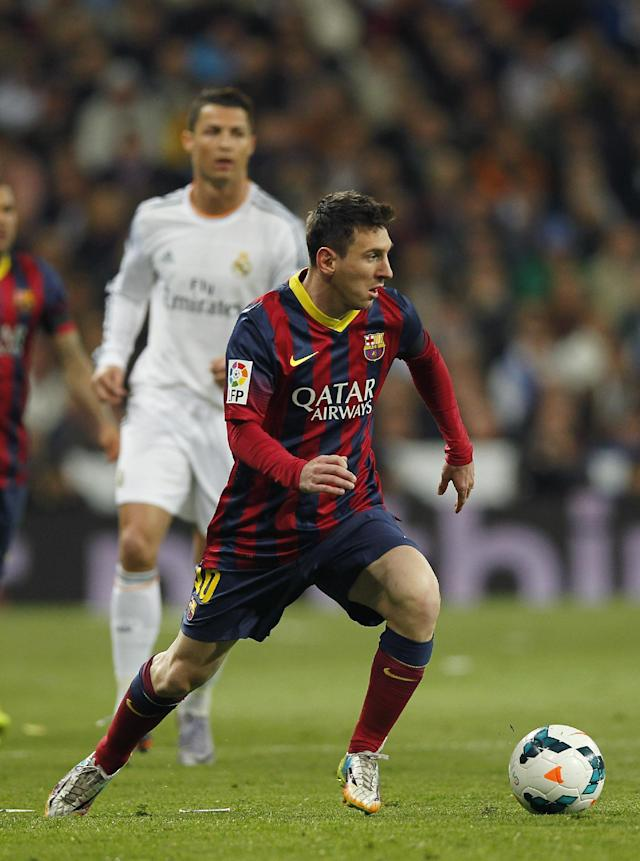 Barcelona's Lionel Messi from Argentina, foreground, controls the ball near to Real's Cristiano Ronaldo, left, during a Spanish La Liga soccer match between Real Madrid and FC Barcelona at the Santiago Bernabeu stadium in Madrid, Spain, Sunday, March 23, 2014. (AP Photo/Andres Kudacki)
