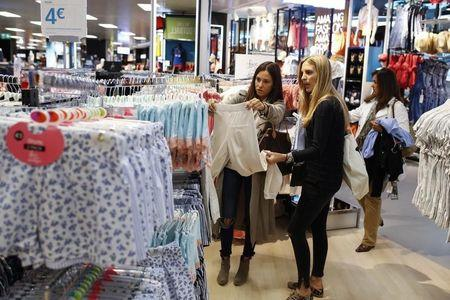 Women look at clothes at Primark's largest store in Spain so far after its opening outside Madrid May 20, 2014. REUTERS/Javier Barbancho