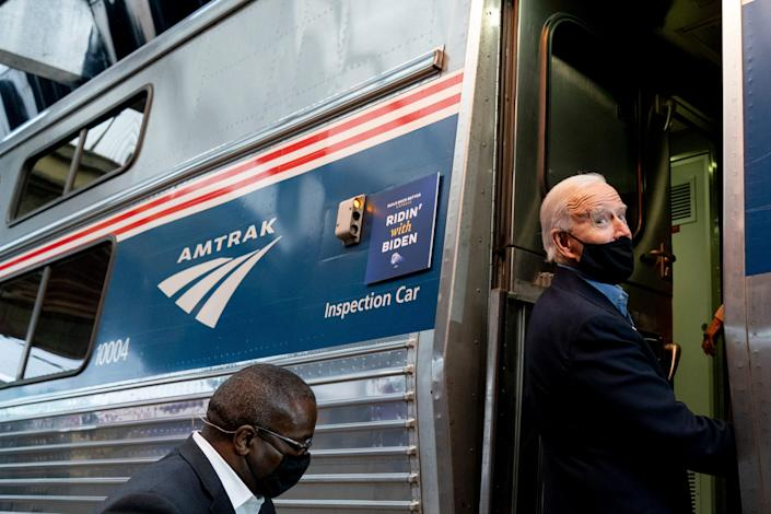 President Joe Biden boards his train at Amtrak's Pittsburgh Train Station, Wednesday, Sept. 30, 2020, in Pittsburgh. Biden took an Amtrak train tour through Ohio and Pennsylvania while campaigning for the presidency. (AP Photo/Andrew Harnik) ORG XMIT: PAAH162