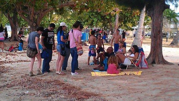 Students at the University of Puerto Rico at Mayagüez recruit volunteers for genomic research at the beach in Fajardo on the far eastern end of the island.