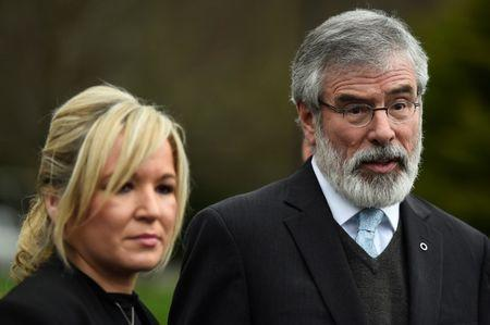 Sinn Fein President Gerry Adams and Sinn Fein leader Michelle O'Neill speak to media outside Stormont Castle in Belfast