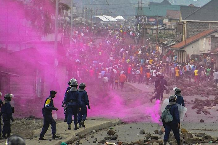 Flares are launched by DR Congo Police forces against protestors in Goma who demanded the resignation of President Joseph Kabila on September 19, 2016 (AFP Photo/Mustafa Mulopwe)