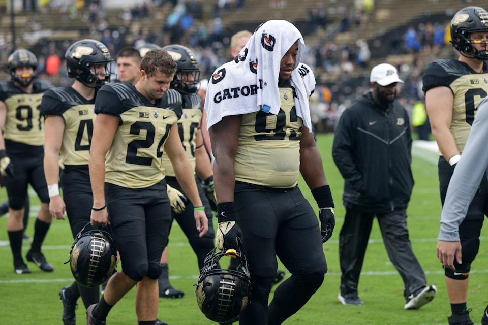 Purdue players walk off the field after being defeated by Minnesota, 20-13, Saturday, Oct. 2, 2021 at Ross-Ade Stadium in West Lafayette, Ind.