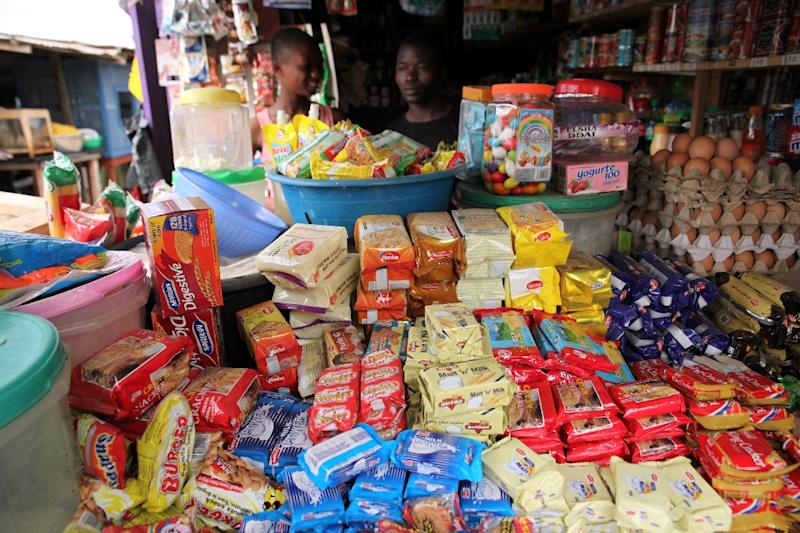 A man stands in his shop in Accra on February 11, 2014