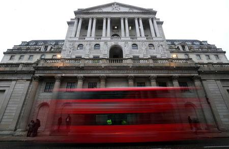 FILE PHOTO: A bus passes the Bank of England in London, Britain, April 9, 2018.  REUTERS/Hannah McKay/File Photo