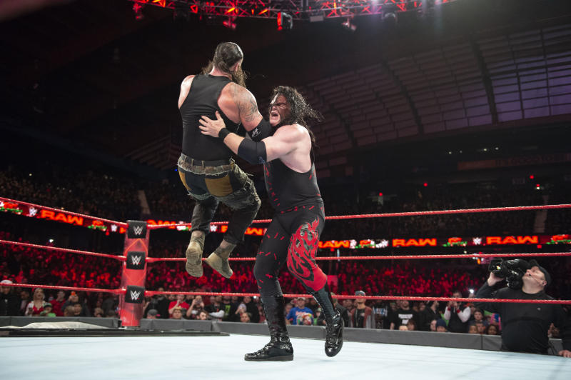 "WWE star Kane chokeslams Braun Strowman during an episode of ""Monday Night Raw."" (Photo courtesy of WWE)"