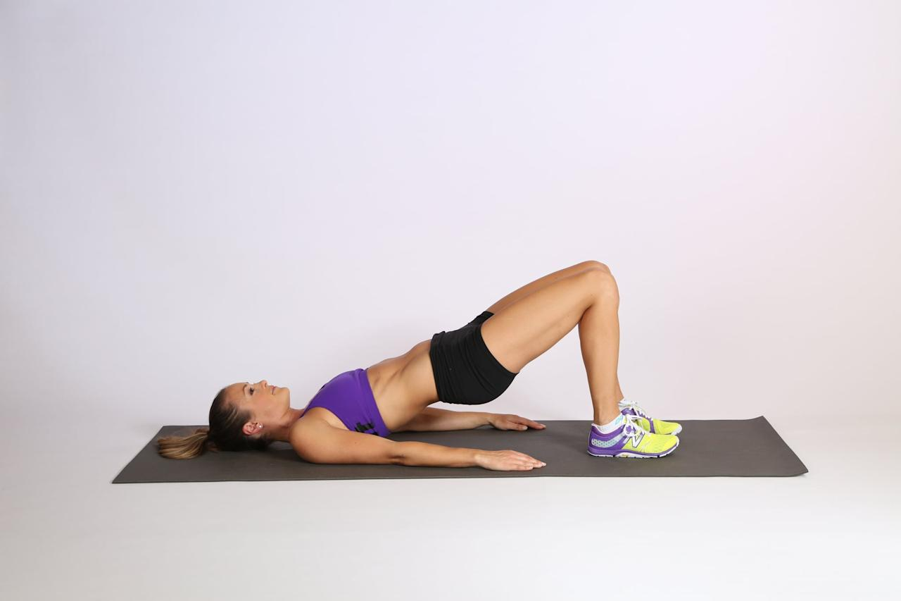 <ul> <li>On your mat, lie on your back with your knees bent and feet flat on the floor. Be sure to keep your feet underneath your knees, not in front. Plant your palms by each side, facing down.</li> <li>Press through your heels to raise your hips up to the ceiling, tensing your abs and squeezing your butt as you do. You should be making a long diagonal line with your body, from shoulders to knees.</li> <li>Hold for a few seconds, making sure your spine doesn't round and your hips don't sag. Keep your abs and butt muscles engaged.</li> <li>Lower down to the ground; this is considered one rep.</li> </ul>