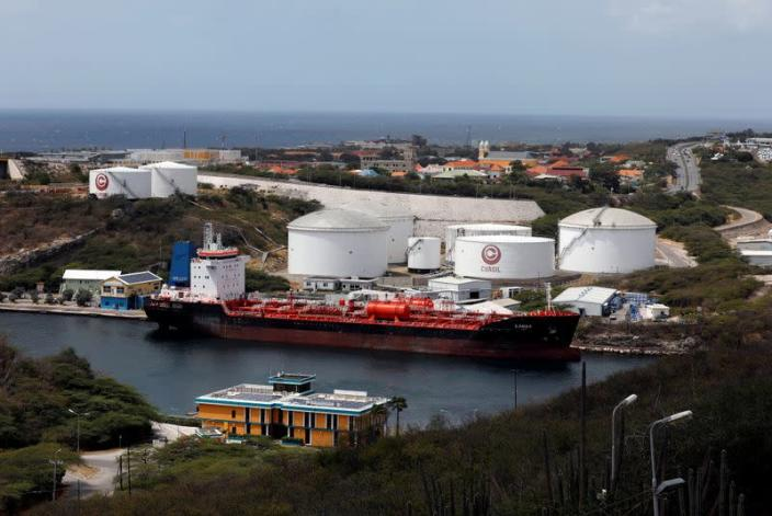 FILE PHOTO: A crude oil tanker is docked at Isla Oil Refinery PDVSA terminal in Willemstad on the island of Curacao