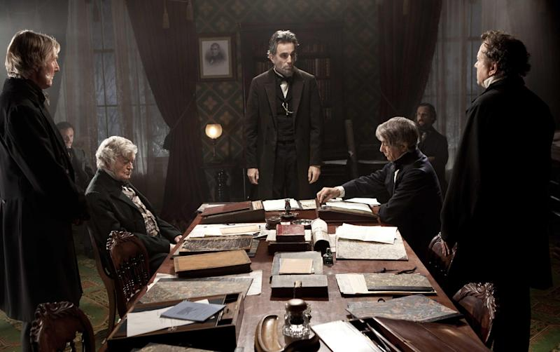 """FILE - This undated publicity photo released by DreamWorks and Twentieth Century Fox shows, Daniel Day-Lewis, center rear, as Abraham Lincoln, in a scene from the film, """"Lincoln.""""  Disney is making more prints of director Steven Spielberg's historical saga to meet theater owners' unexpected demand. The DreamWorks film earned $25 million at the box office last weekend, lifting its domestic revenue to $62.2 million. (AP Photo/DreamWorks, Twentieth Century Fox, David James, File)"""