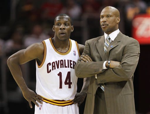 Cleveland Cavaliers' Lester Hudson (14) talks with coach Byron Scott in the first half of an NBA basketball game against the San Antonio Spurs in Cleveland on Tuesday, April 3, 2012. (AP Photo/Amy Sancetta)