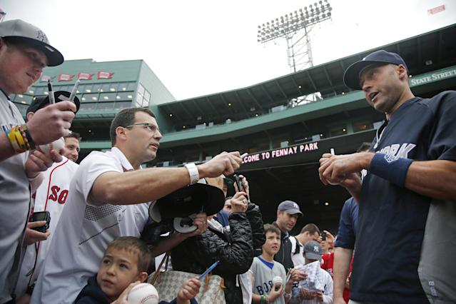 New York Yankees' Derek Jeter chats with fans as he signs autographs prior to the Yankees' baseball game against the Boston Red Sox at Fenway Park in Boston, Tuesday, April 22, 2014. (AP Photo/Elise Amendola)