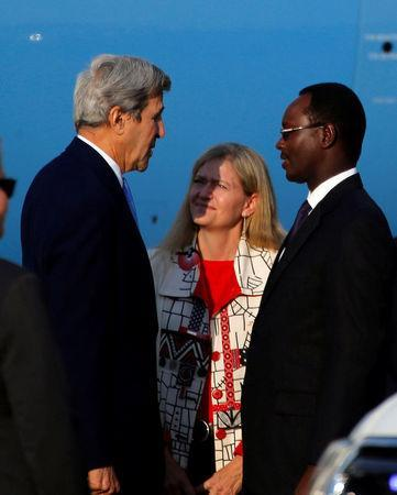 U.S. Secretary of State John Kerry (L) is welcomed as he arrives at Kigali international airport in Rwanda capital to promote US climate and environmental goals at the Meeting of the Parties to the Montreal Protocol on the elimination of hydro fluorocarbons (HFCs) use, October 13, 2016. REUTERS/James Akena