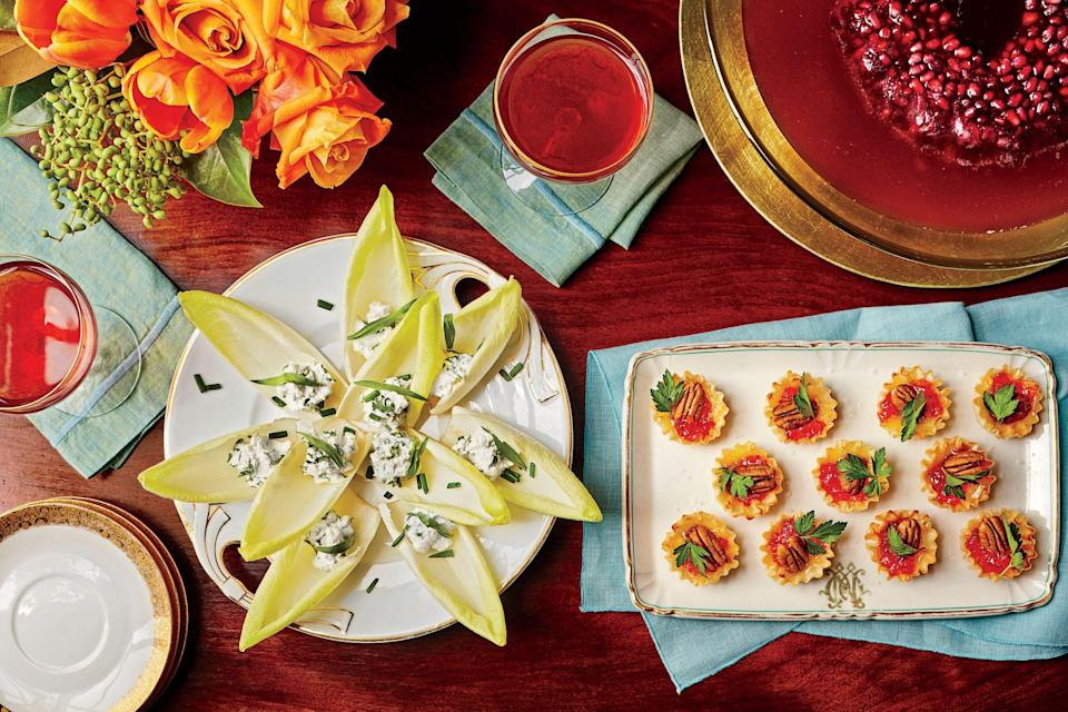 """<p><strong>Recipe: <a href=""""https://www.southernliving.com/recipes/baked-brie-bites-recipe"""" rel=""""nofollow noopener"""" target=""""_blank"""" data-ylk=""""slk:Baked Brie Bites"""" class=""""link rapid-noclick-resp"""">Baked Brie Bites</a></strong></p> <p>This impressive appetizer couldn't be easier. We recommended keeping the frozen mini phyllo pastry shells on hand during the holiday season for drop-in guests. </p>"""