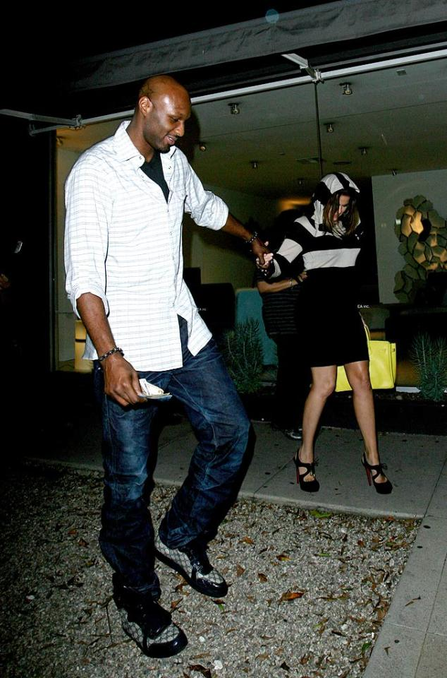 """Ever the gentleman, Lamar helped his lady make her way back to their car safely in her sky-high Louboutins. Roshan Perera/<a href=""""http://www.splashnewsonline.com/"""" target=""""new"""">Splash News</a> - August 22, 201"""