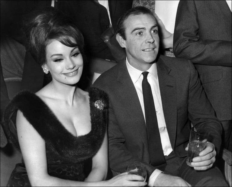 In this file photo taken on February 19, 1965 Connery and his screen partner Claudine Auger answer journalists' questions in Paris