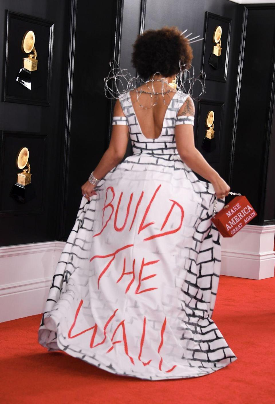 """<p>Singer Joy Villa has chosen some unusually political outfits for her red carpet appearances, including this <a href=""""https://www.insider.com/build-the-wall-dress-grammys-2019-2"""" rel=""""nofollow noopener"""" target=""""_blank"""" data-ylk=""""slk:&quot;Build the Wall&quot; dress she wore to the 2019 Grammys"""" class=""""link rapid-noclick-resp"""">""""Build the Wall"""" dress she wore to the 2019 Grammys</a>, as a message of support for then-President Trump's plan to build a wall on the US-Mexico border. </p>"""