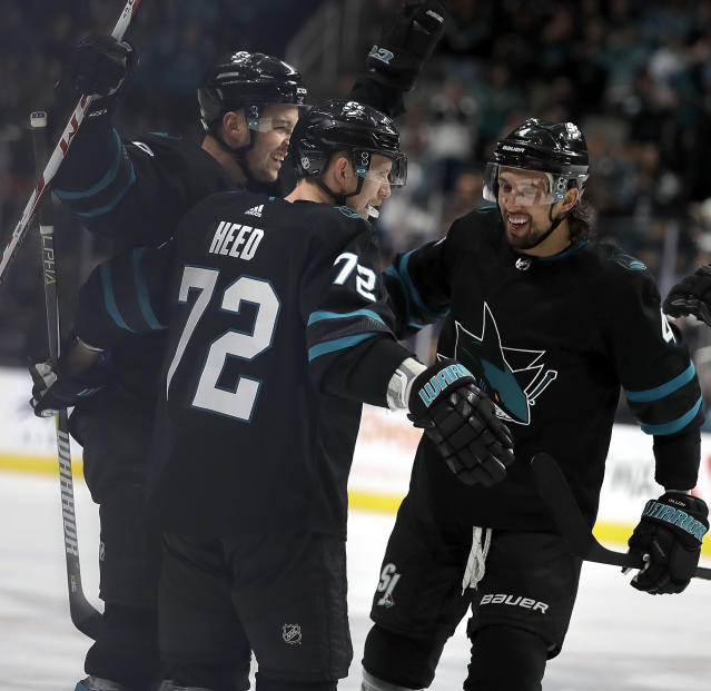 San Jose Sharks' Tomas Hertl, left, celebrates with Tim Heed (72) and Brenden Dillon, right, after scoring a goal against the Montreal Canadiens during the first period of an NHL hockey game Thursday, March 7, 2019, in San Jose, Calif. (AP Photo/Ben Margot)
