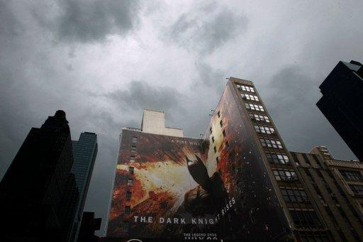 """Heightened police presence at a movie theater in Times Square in New York before a showing of """"The Dark Knight Rises"""". With a fixation on random violence, Gotham City dysfunction and the death of a star, the """"Batman"""" movies have long been consumed with tragedy and terror. Now an unfathomable horror is forever linked to the series"""