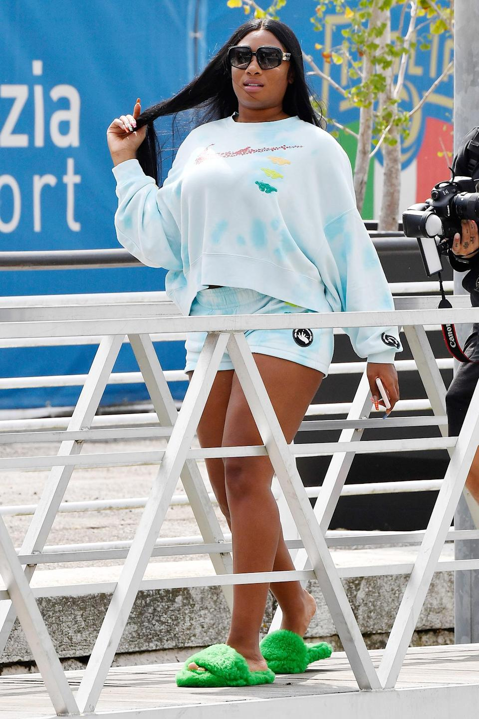 <p>Megan Thee Stallion is seen arriving at the Venice airport after the Dolce & Gabbana fashion show on Aug. 31. </p>