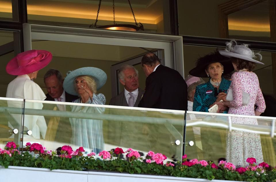The Duchess of Cornwall alongside the Prince of Wales in the Royal Box on day one of Royal Ascot at Ascot Racecourse. Picture date: Tuesday June 15, 2021.