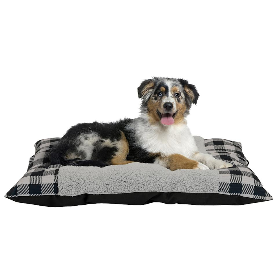 "<p>You can't forget to scoop up a little something for the furry friend in your life. This plush bed is a perfect surprise for Fido to nap on all winter long.<br /><strong><a rel=""nofollow"" href=""https://fave.co/2QL21Tj"">Shop it</a></strong> $10, <a rel=""nofollow"" href=""https://fave.co/2QL21Tj"">walmart.com</a> </p>"