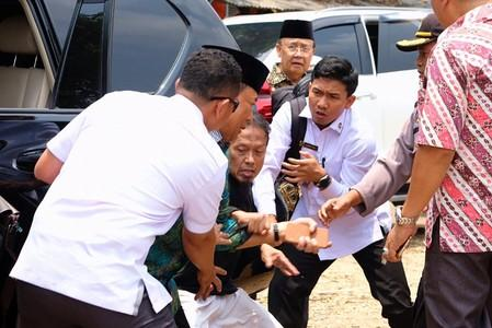Indonesia's Chief Security Minister Wiranto is pictured as he being attacked during his visit in Pandeglang