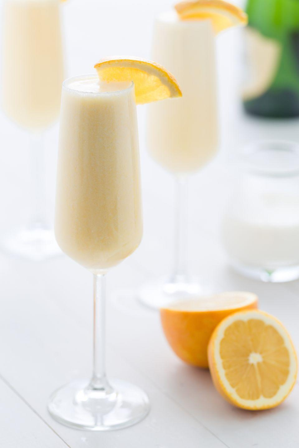 """<p>Think of these as the grown-up way to drink an Orange Julius. </p><p>Get the recipe from <a href=""""https://www.delish.com/cooking/recipe-ideas/recipes/a46969/orange-creamsicle-mimosas-recipe/"""" rel=""""nofollow noopener"""" target=""""_blank"""" data-ylk=""""slk:Delish"""" class=""""link rapid-noclick-resp"""">Delish</a>.</p>"""