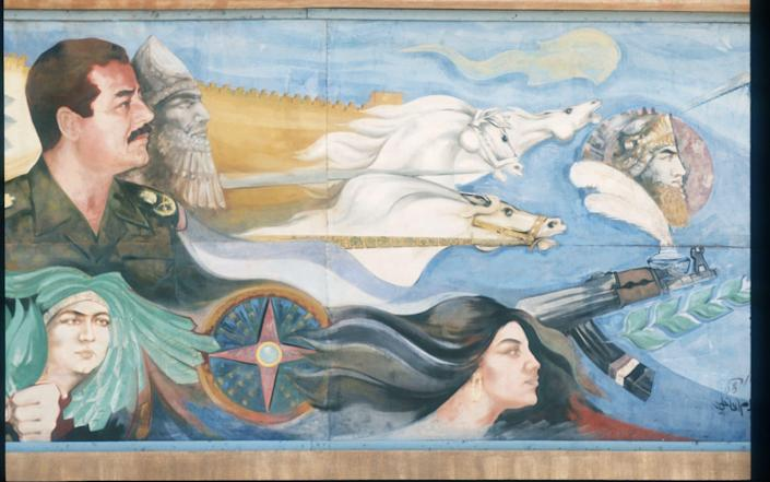 A 1990s mural of Saddam with Nebuchadnezzar behind him Daily Life In Iraq - Scott Peterson/Liaison